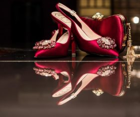 Female wedding red high heels and bag Stock Photo