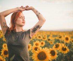 Flower sea woman meditating Stock Photo