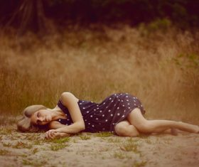 Lying on the ground posing woman Stock Photo