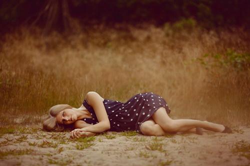 Lying on the ground posing woman Stock Photo
