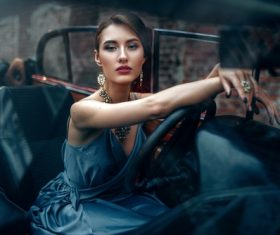 Make-up woman sitting in the car Stock Photo