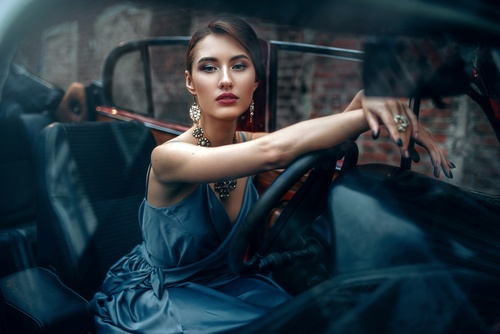 Make up woman sitting in the car Stock Photo