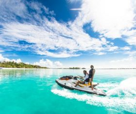 Men and women driving speedboats on the water Stock Photo