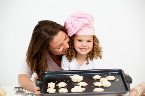 Mother and daughter making cookies together Stock Photo 10