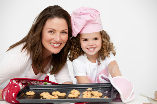 Mother and daughter making cookies together Stock Photo 11