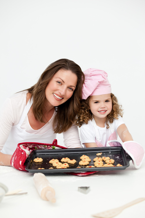 Mother and daughter making cookies together Stock Photo 12