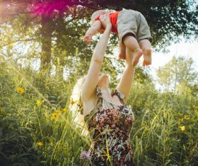 Mother lifted the baby up high Stock Photo