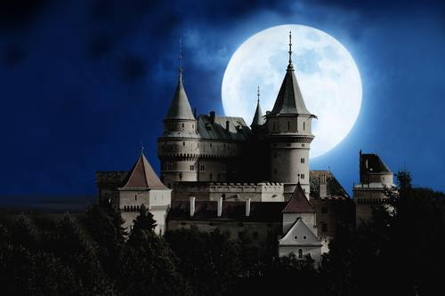 Night castle and the moon in the sky Stock Photo