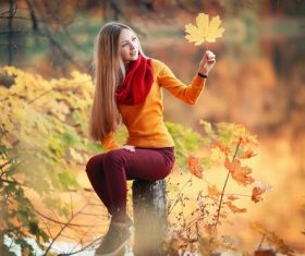 Pretty girl holding yellow maple leaf Stock Photo