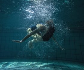 Somersault people in the water Stock Photo