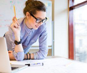 Stock Photo Woman looking at design drawings