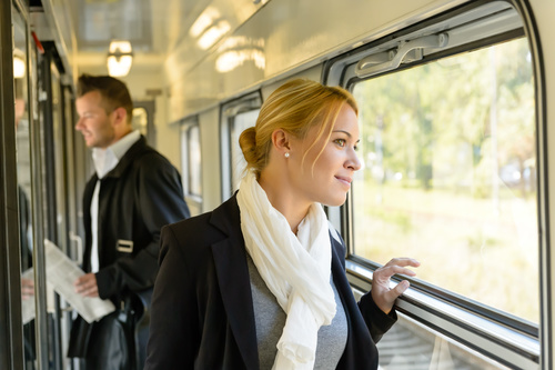 Stock Photo Woman looking at the scenery outside the car window