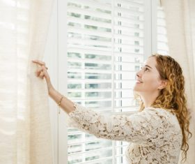 Stock Photo Woman opens the curtain 01