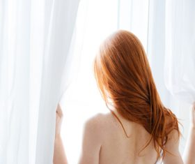 Stock Photo Woman opens the curtain 03