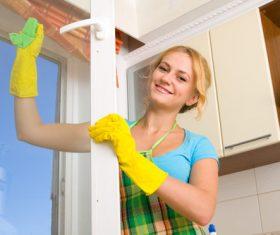Stock Photo Woman wiping the window 01