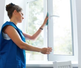Stock Photo Woman wiping the window 02