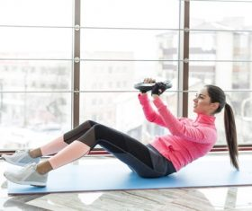 Woman doing abdominal and back exercises Stock Photo