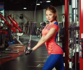 Woman exercising in the gym Stock Photo