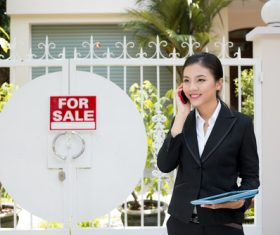 Young beautiful real estate agent Stock Photo