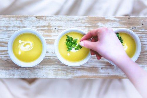 leek and potato soup hand Stock Photo