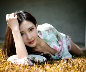 Asian girl lying on the lawn Stock Photo