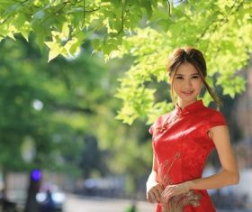 Asian girl wearing red cheongsam smiling Stock Photo