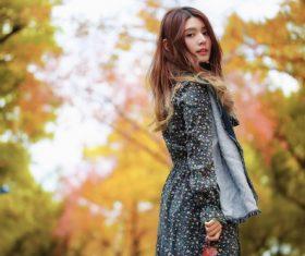 Beautiful Asian girl on the street in autumn outdoor Stock Photo