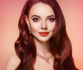 Beautiful woman face makeup artist applies eyeshadow Stock Photo