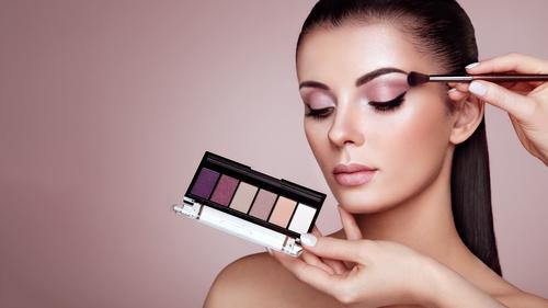 Beautiful woman face makeup artist applies eyeshadow Stock Photo 04