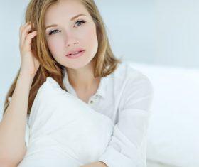 Beautiful woman holding white pillow Stock Photo
