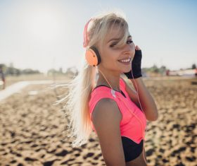 Beautiful woman listening to music Stock Photo 04