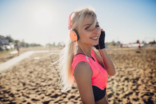 Beautiful woman listening to music Stock Photo 04
