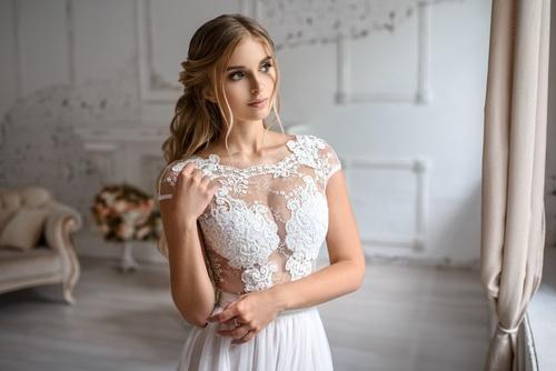 Beautiful woman wearing white lace blouse Stock Photo