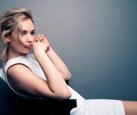 Beautiful women model sitting on chair Stock Photo