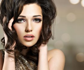 Beautiful young girl modern make-up and hairstyle Stock Photo