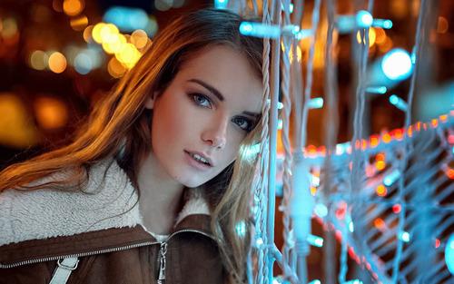 Blonde long hair woman in brown jacket Stock Photo