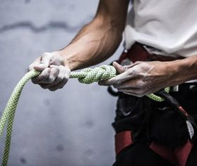 Checking rock climbing rope people Stock Photo