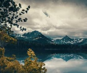 Cloudy sky snow mountain lake scenery Stock Photo