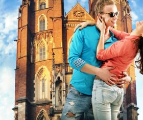 Couple hugging in front of the church Stock Photo