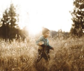 Cute little boy on the grass outdoors Stock Photo