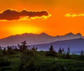 Dusk evening mountains bushes natural scenery Stock Photo