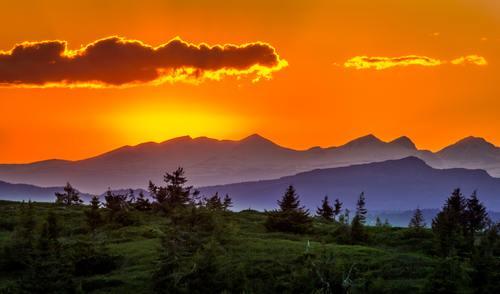 Dusk evening mountains bushes natural scenery Stock Photo