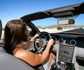 Female driver concentrating on driving Stock Photo