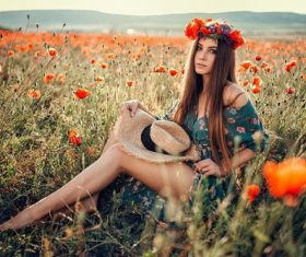 Female model sitting in wildflowers posing Stock Photo