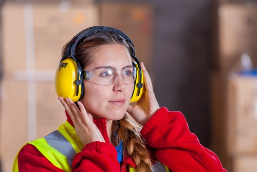 Female shooter wearing ear protectors Stock Photo