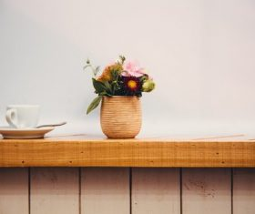 Flower arrangement and coffee cup on the windowsill Stock Photo
