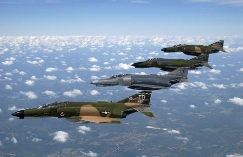 Four fighters in the air formation Stock Photo