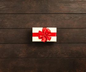 Gift box close-up on wooden table Stock Photo