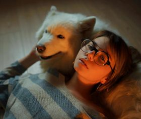Girl and beloved pet dog Stock Photo