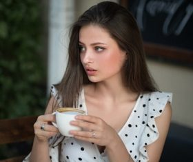 Girl looking at the distance with coffee Stock Photo